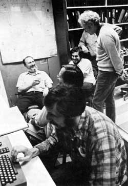 Success is measured on the faces (left to right) of M. Hentges (at keyboard), P. Martin, G. Tool, D. Wolff, L. Lederman (standing), and P. Limon (background)