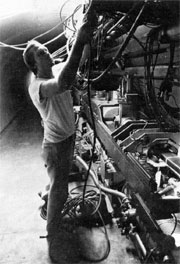 Bruce Kling purges the pneumatic control system in the Main Ring tunnel