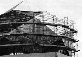 Repair and renovation in progress on the geodesic dome of the 15-foot Bubble Chamber Assembly Building