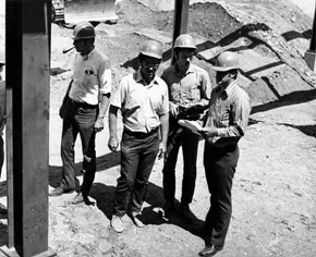 (L. to R.) Richard Orr, Dick Gustafson, John Chinowski and Don Richied supervise the placement of University of Michigan experimental equipment into the eperimental area of the National Accelerator Laboratory Meson Lab. July 30, 1971