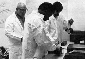 B. Thomas, G. Johnson and R. Bailey proton Department wrap blocks of beryllium for the target box