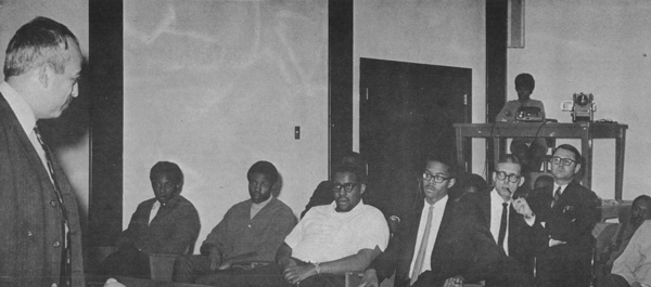 Dr. Edwin L. Goldwasser (left) shown briefing minority members of NAL's first major technical training program for inner-city residents
