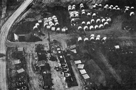 An aerial view of one of the two casting yards on the NAL construction site. Main Ring sections are pre-cast in the cubicles at the left. They are stored in the field and transported by truck to the nearby Main Ring excavation as they are needed.