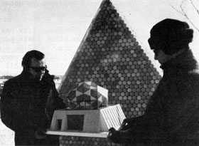 Main Ring's Bob Sheldon (left) shows model of translucent, honeycomb effect of proposed Bubble Chamber geodesic dome to Hank Hinterberger, NAL Technical Services. Dome will be made of discarded beverage cans