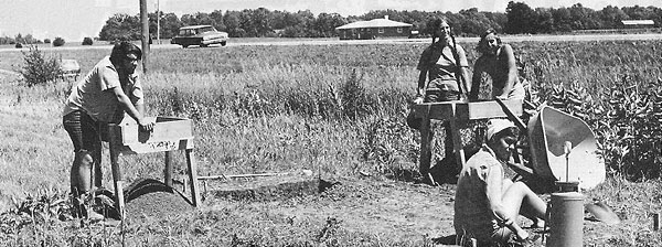 "NAL's summer archaeologlcal team dig and sift for artifacts at the ""Pohl"" site near Butterfield road. They include (Left to Right) Tom Dickens, Nancy and Alan Randlov and Ellen Fowler (seated)"