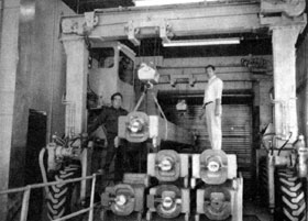 (L to R) Tony Winchester, Halbert Landers, (in cab) and George Hill operate the giant magnet handling device