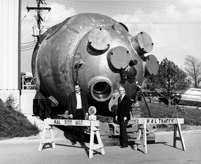 (L to R) Drs. F. R. Huson and Wm. B. Fowler of NAL Bubble Chamber Section, with the newly-arrived 15 ft. bubble chamber