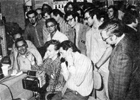 200 BeV victory in the NAL Main Control Room. Front row, seated (L to R), Francis T. Cole, Jeff Cannon, John Clarke. Standing (L to R) Dick Cassel, Ryuji Yamada, Bruce Strauss, Paul Evan, Will Hanson