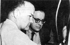 Donald E. Young, Accel. Section, and James R. Sanford, Assoc.Dir. for Program Plan., at the oscilloscope