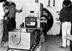 Inserting target train into target tube of Neutrino Lab.(L to R):A.J.Bianchi, J.Guerra, D.Carpenter, G.Krafczyk, J.Simon, L.Read