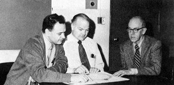 Awschalom, Radiation Physics, Donald E. Young, who directed development of NAL's Linac, and Professor Lester Skaggs, of the University of Chicago, discuss cancer therapy unit proposal during recent meeting at NAL