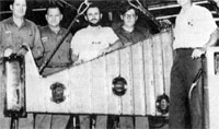 Ion guide built by NAL Machine Shop staff: (L to R) Jim Forrester, Walt Limbough, Jim Schmidt, Roger Hitler, Tom Butler