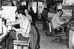 (L to R) Larry Semsch, Ted Ulijasz, Bob Young, R. Mahler, and Karl Schmidt, members of the Controls Group of the Accelerator Section, working on the ground floor of the Central Laboratory building