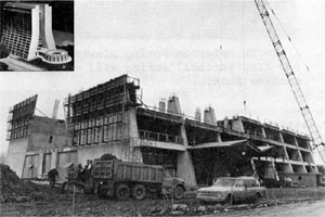 Phase II of high rise construction of the Central Laboratory extended the building from its January, 1972 level, above, to the 16 stories shown in the inset. Pedestrians may enter through the low enclosed wooden runway at right, which also leads to the lunch area