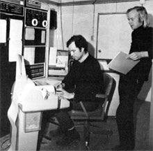 (L to R) Stewart Loken and Paul Kunz, members of Experiment 26 group, working on computer calculations