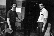 J. Peoples (L), L. Read (Proton Section) enter by south door of Central Lab