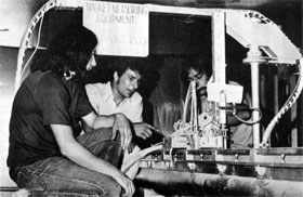 C. Worel, R. Doyle, P. Burton, completing assembly of the device on the top of the magnet which measures the magnet field for Experiment 98 in the Muon Area, the first experiment to use the magnet in its new home