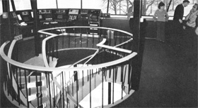 Two interlaced spiral staircases lead up to control center