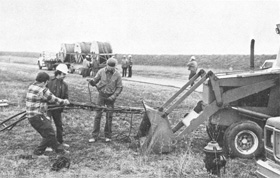 Tying down cable to a tractor before takeoff