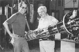 G. Kalbfleisch (L) and J. O'Meara beam about successful magnet test
