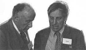 J. Wheeler (L), U. of Texas, and R. Wilson, Harvard, talk during break