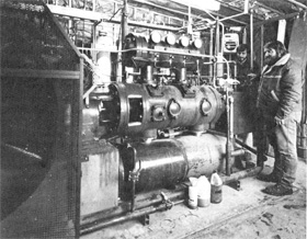 Mike Hentges (L), Jack Johnson at refurbished compressor of purification system