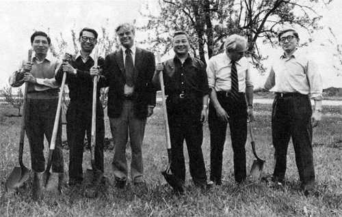 On Arbor Day 1978, Chinese visitors helped Fermilab employees, including Director Robert R. Wilson and Deputy Director Edwin L. Goldwasser, plant trees