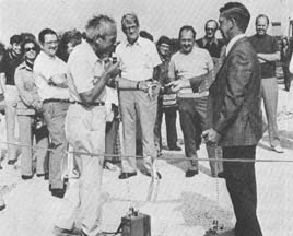 E.L. Goldwasser providing scissors to Mayor Robert Brown